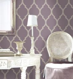 Love the purple and metallic wallpaper. Master bedroom accent wall..