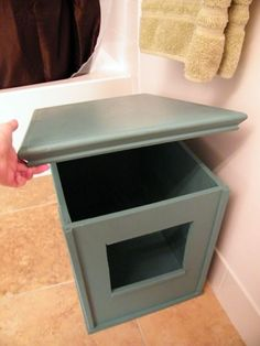 Make your own cat litter box cover of MDF. Hinge corners to be collapsible.  No floor so entire box can be lifted right up and folded.