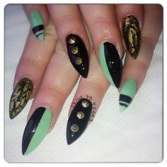 Turquoise and black soak off gel, metal studs. Gold crackle nail varnish.
