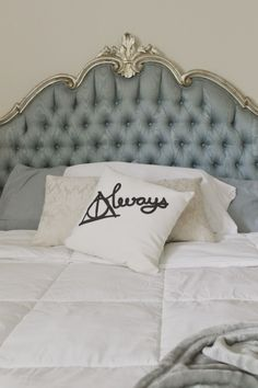 Vintage Hollywood Regency headboard with Harry Potter pillow and neutral bedding inspiration via Fashionhista