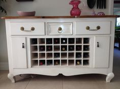 Dresser turned into buffet with wine rack.