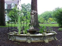 Our Formal Surround Fountain. Shown with Girl With Shell Centerpiece. On display on the Garden Walk at Southern Grace.