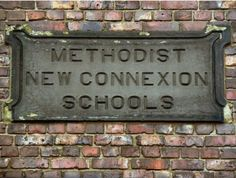Methodist New Connexion School (plaque)  Stone plaque above the first floor windows of the former Sunday school building on Smyrna Street  Woodmod (Former Sunday School)).