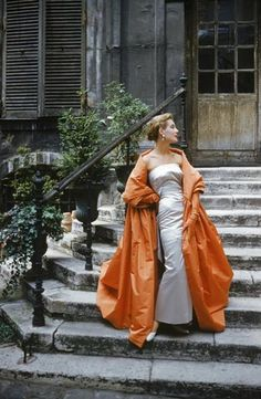 Couture in a Paris coutyard photographed by Mark Shaw, 1955.