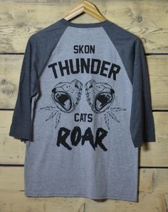 Unashamedly taking inspiration from an 80's kids cartoon, we proudly present our SKONThunder cats raglan. 1oo% ringspun cotton and a unisex fit, finished with our double sided design embroidered hem and neck labels. This tee comes a little looser than some of our other shirts but is still an uber quality/flattering fit