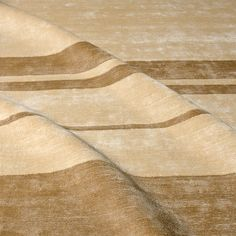 #8001-0301 Ollie Stripe Irregular-Tobacco/Oat  A rich, dense, low pile 100% Linen Shag, this irregular stripe works in both traditional and modern interiors.  Available in any size