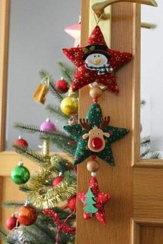 me ~ Christmas tree decoration. Very simple, 15 stuffed triangles with small baubles hanging between. Fabric Christmas Trees, Hanging Christmas Tree, Handmade Christmas Tree, Handmade Christmas Decorations, Felt Christmas Ornaments, Christmas Tree Decorations, Christmas Sewing, Christmas Wreaths, Christmas Crafts