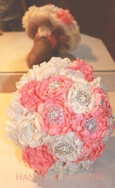 Gorgeous Coral Peony Brooch Bouquet with a burlap wrap From HandyMandyGirl, an Etsy Shop.  Please mention that you found them thru Jevel Wedding Planning's Pinterest Account.  Keywords:  #coralthemedweddingideasandinspirations #coralbroochbridalbouquet #jevelweddingplanning Follow Us: www.jevelweddingplanning.com  www.facebook.com/jevelweddingplanning/