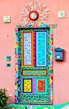 Bright colours adorn this charming front door!