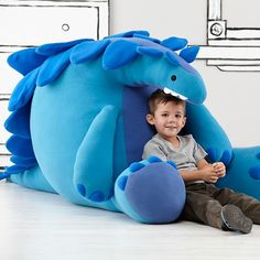 How fun is this? Not sure if I could pull off something on this scale--think of the cost of the stuffing!--but it's very cool. Love the details. Giant Stuffed Dinosaur Toy | The Land of Nod.