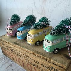 This 1967 VW Bus carries a bottle brush Christmas tree on top and hangs on your Christmas tree by red and white bakers twine. The Bus is the size of a matchbox car, measuring 2.5 inches long.  Available in pink, mint green, butter yellow, and light blue.
