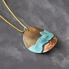 Layered Landscape Brass Necklace                                                                                                                                                                                 More