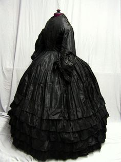 1850's -1860's Civil War Era Black Silk Dress. Can you imagine ever wearing that thing. No way!