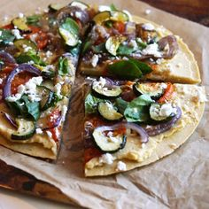 This Gluten-free Mediterranean Chickpea Flour Pizza is easy to make and loaded with flavor, and a healthy serving of fiber and protein.