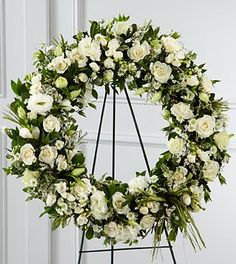 The FTD® Splendor™ Wreath is a symbol of lasting love and kinship, whether for the deceased or in comfort of those suffering from a loss. Elegant white freesia, double lisianthus, spray roses, Monte C