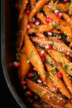 Honey Maple Roasted Carrots - these are like candy, everyone always wants second helpings! This recipe definitely transforms everyday carrots into something spectacular!