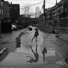 Rachel Cossar: The dancer arches her back gracefully, a thing of beauty in a wet and dingy-looking back alley in Boston