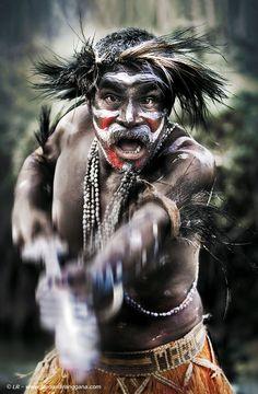 Asmat Warrior; photograph by Leonardi Ranggana. Irian Jaya (Papua New Guinea)