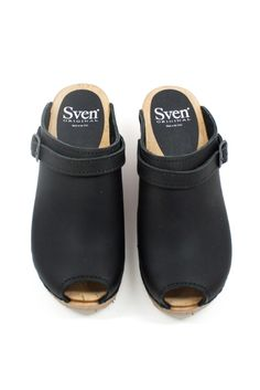 """This classic style clog from Sven features simple style with fun details like buckles and a peep-toe. We love them paired with a flowing midi skirt. Details: Leather upper, wooden base. 3"""" heel. Sven"""