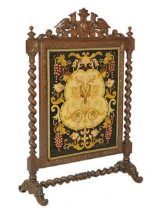 A HENRY II WALNUT AND NEEDLEPOINT FIREPLACE SCREEN French 19th Century