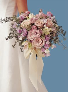 Softly colored roses exude a romantic feeling. Here lavender roses mix with sweet peas and parrot tulips in the same palette. Sage-colored seeded eucalyptus keeps in the soft tones.    Flowers by Rebecca Cole, New York, NY.