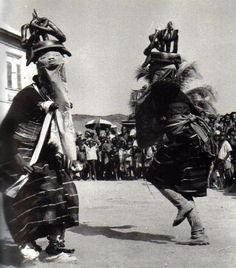 """The Gelede masquerade of Western Yorubaland, which honors the older women, ancestors and deities known as """"mothers"""" (Iya mi, my mother) of the community utilized these wrappers, as seen in this early 20th Century photograph."""