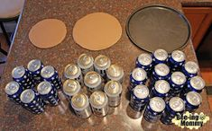 Beer Can Cake Tutorial - 30 beers, pizza pan, cardboard and decorationsYou can find Beer cakes and more on our website.Beer Can Cake Tutorial - Beer Can Cakes, Beer Cakes Diy, Alcohol Cake, Alcohol Gifts, Cake In A Can, Cake Tower, Beer Gifts, Beer Cake Gift, Diy Birthday