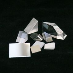 Kit: Prisms : 2 Light Crystals, 2 acrylic right angle prisms (copy 2 contains only 1 acrylic right angle prism and also has 4 acrylic, 60x60x60 Prisms), 1 glass right angle prisms, 1 acrylic square prism (in container), and 1 RIVE box optic set (including a double convex lens, double concave lens, convex mirror, concave mirror, and plane mirror). Convex Mirror, Concave, Colored Diamonds, Lens, Container, Crystals, Science, Kit, Accessories