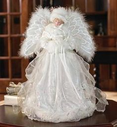 White snow angel perfect for the top of the tree or to display on a table.