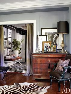 A doorway is framed by Restoration Hardware linen curtains customized with a border from M&J Trimming.