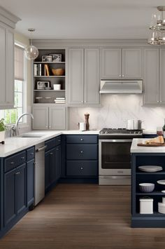 Navy blue cabinets are a trending color that will continue to be a statement in your kitchen for years to come. Merillat® Nightfall can be paired with Shale or Cotton for a coastal or modern design… Blue Gray Kitchen Cabinets, Kitchen Cabinet Colors, Painting Kitchen Cabinets, Kitchen Cabinets Designs, Navy Blue Kitchens, Classic Kitchen Cabinets, Cabinet Paint Colors, Shabby Chic Kitchen, Kitchen Decor