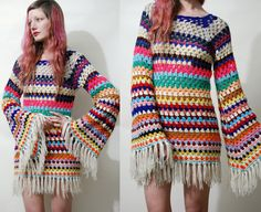 "☩ CROCHET BELL SLEEVE DRESS One of a kind dress made by Crux and Crow Handmade with 70s vintage colourful stripe crochet Mini length with fringe edges Flared bell sleeves, fitted body Sheer open crochet Great for winter layering  Label: Crux and Crow Size on tag: - Best fit: XS Fabric: Wool Acrylic mix Condition: Excellent, handmade with vintage materials  ☩ M E A S U R E M E N T S Length: 82cm (32"") ~including fringe Bust: 39cm (15) Waist: 36cm (14"") Hips: 44cm (17"") Sleeve: 64cm (25"")…"