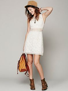 Lace Cutout Shift White lace dress with brown boots (or sandals), belt and beaded necklace