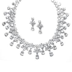 Add the glamour you're looking for with this Romantic vintage inspired necklace and earrings set for second time around brides with marquis, pear and oval cubic zirconia for your special day.