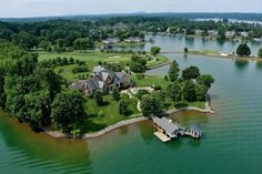 The most unbelievable custom home on Smith Mtn Lake located on private 6 acre pointe w/panoramic views of SML and Island Green hole #7. Featuring 3000 sqft boat dock, swimming pool, 1220 sqft guest ste, custom millwork and theater rm. List price of home includes the sale of The Water's Edge Country Club which incl. all assets of the course and club. See MLS # 818062 for club & course details.