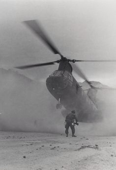 A Marine CH-46 Sea Knight helicopter of Marine Medium Helicopter Squadron 265 [HMM-265] drops into a zone on Highway 1 near Da Nang