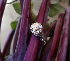 Exquisite 1920's 2.11 carat Old European cut diamond set in a beautifully detailed platinum mounting.