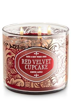 """Red Velvet Cupcake - 3-Wick Candle - Bath & Body Works - The Perfect 3-Wick Candle! Made using the highest concentration of fragrance oils, an exclusive blend of vegetable wax and wicks that won't burn out, our candles melt consistently & evenly, radiating enough fragrance to fill an entire room. A beautiful pattern of metallic paisley adds design to any space. Topped with a flame-extinguishing lid! Burns approximately 25 - 45 hours and measures 4"""" wide x 3 1/2"""" tall."""
