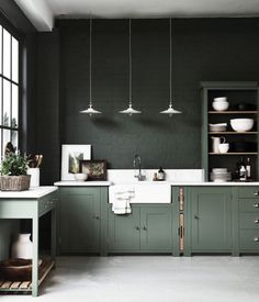 painted brick wall - same colour as cabinets