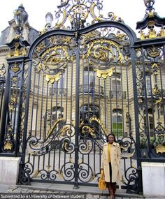 UD Student, Denise Wakiaga studying Fashion in Paris, France, poses in front of such a stunning gate.  #UDAbroad