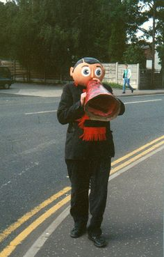 Frank Sidebottom conducting a Timperley walkabout, Greater Manchester, England, United Kingdom, 1989, photograph by Mark Phillips.