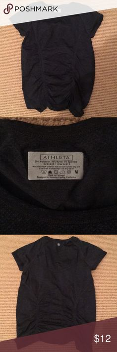 """Athleta t shirt Excellent condition dark grey and black heather t shirt. Poly/spandex and nylon. Rouching in torso. Silicone inside bottom hem so it doesn't ride up. 23"""" long Athleta Tops Tees - Short Sleeve"""