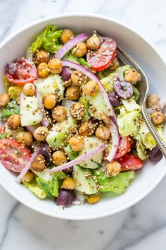 A simple vegan chopped salad with a tarragon tahini dressing and warm spiced chickpeas. It's light, flavorful, easy to make and packed with protein!