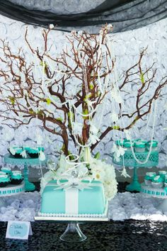 A gorgeous cake created to resemble a Tiffany's gift box is a stunning centerpiece for your dessert table!