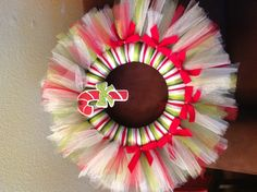 Christmas tulle wreath.  This would be way cute done with a little girls favorite colors and some ballet slippers or her favorite thing in life.
