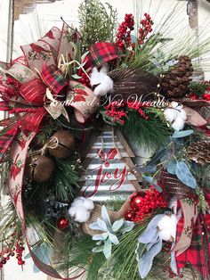 This Warm and Rustic Christmas Wreath is made on a Grapevine Base. I have Added an Assortment of Woodsy Pines, A Touch of Sparkly Pine, Red Berries, Cream, Brown and Gray Pip Berries, Some Small Herbs, and a Sprinkling of Rustic Cotton Bolls. I put a Rustic Christmas Tree Sign in Log Cabin Christmas, Christmas Porch, Rustic Christmas, Winter Christmas, Christmas Wreaths For Front Door, Christmas Decorations, Holiday Decor, Door Wreaths, Wreath Crafts