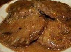 Poor Man's Steak (3 lbs. ground beef, 1 C milk, 1 C cracker crumbs, 2 t salt, 1 can beef gravy)