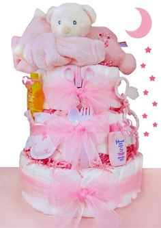 *Please allow 1-2 business days for processing. VIEW SHIPPING RATES/ MAP FOR THIS ITEM This precious Sleepy Bear Diaper Cake is topped off with a soft plush sleepy bear & super soft travel nap time bl