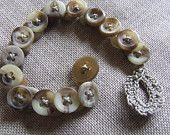 Bracelet with vintage buttons mottled taupe, taupe and wire macrame.