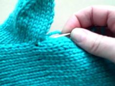 Kelley Petkun from Knit Picks talks about the basics of knitting mittens. Follow along and learn how to knit a pair of mittens! This video teaches you how to finish the thumb on a mitten with a gusset (part 2 of 2).